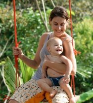 Alli Akard with baby on swing cropped